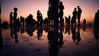 Community - Group of people gathered at sunset